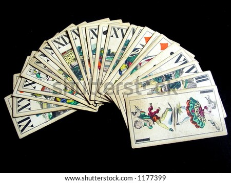 Old casino cards on black background. - stock photo