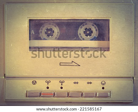 Old cassette player used as background. Retro style. - stock photo