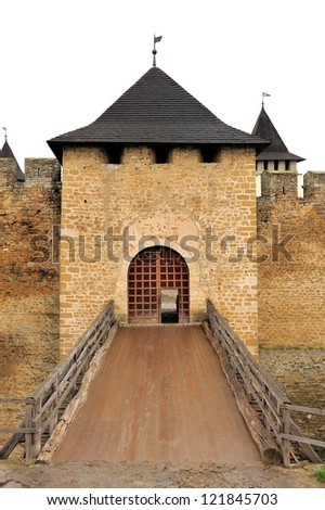 Old castle door and drawbridge isolated on white background - stock photo