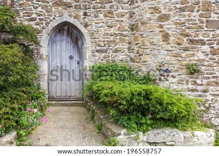 Old castle door closeup seen in Rye, Kent, UK. - stock photo