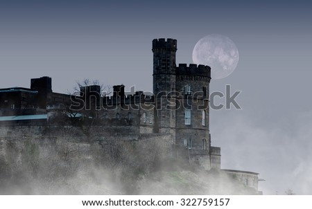 Old castle in the night with moon - stock photo