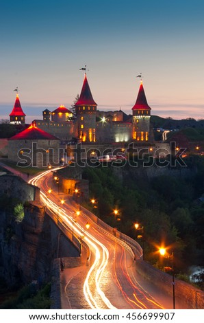 Old Castle Kamenetz-Podolsk - medieval castle, one of the historical monuments of Ukraine. View of a beautiful castle at night. - stock photo