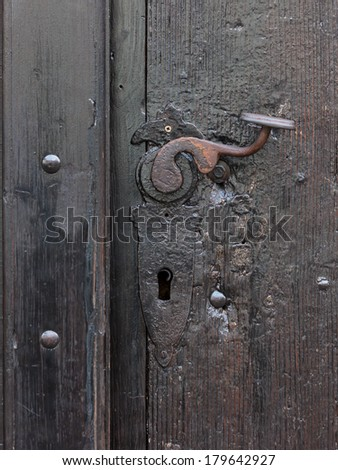 Old castle's rusty door handle close up - stock photo