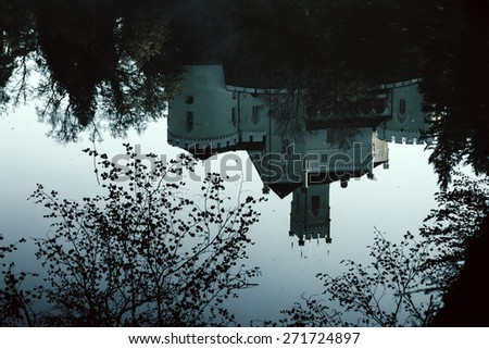 Old castle Trakoscan, Croatia, dark mystic atmosphere, reflection in water - stock photo