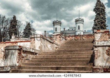 Old castle with stairs under clouds - stock photo