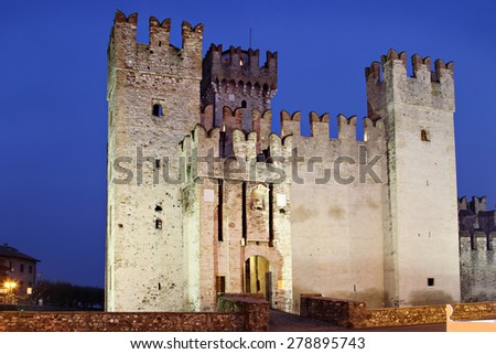 Old castle with towers - the Scaliger Castle in the night, Sirmione, Italy - stock photo