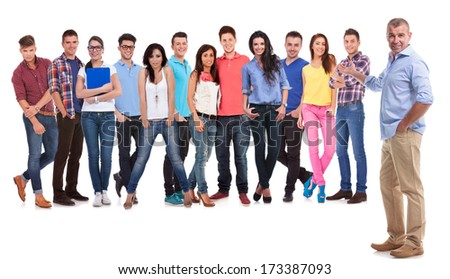 old casual man presenting his young team of people on white background - stock photo