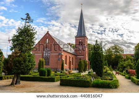 Old catholic church and cemetery in Dragor near Copenhagen, Denmark - stock photo