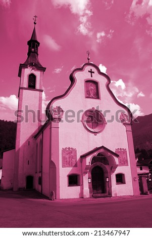 Old catolic church in a quiet mountain town - stock photo