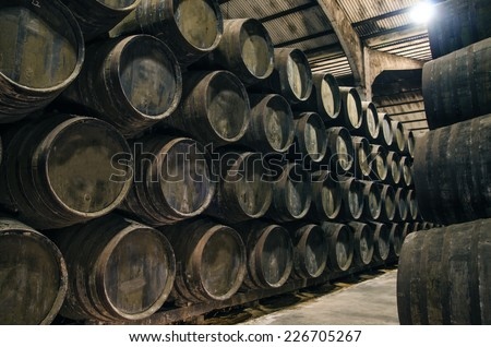 Old cellar with barrels for wine or whiskey - stock photo