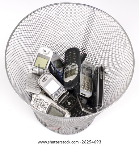 old cellphones in the wastepaper basket - stock photo