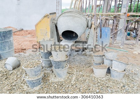 Old cement mixer used in construction - stock photo