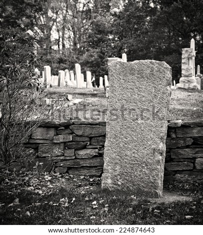 Old cemetary in fall in black and white - stock photo