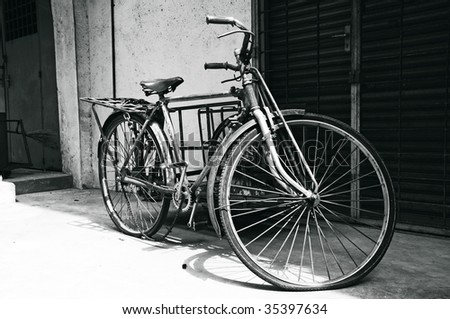 Old century bicycle used for transportation in black and white - stock photo