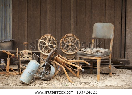 old chair and old wall in thailand - stock photo