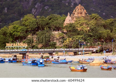 Old cham towers, bridge and boats in Nha Trang, Vietnam - stock photo