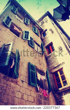 old charming houses with colorful windows - stock photo