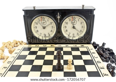 Old chess clock and chessboard  on white - stock photo