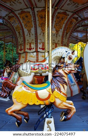 old children's carousel grown old times - stock photo