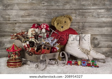Old children toys on wooden background for christmas decoration. - stock photo