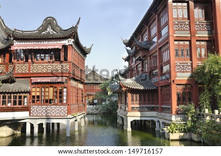 Old Chinatown in Shanghai Beautiful scene surrounded by river of traditional Chinese architecture - stock photo