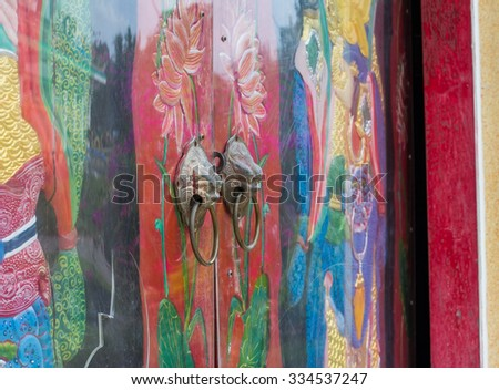 Old chinese door of the temple in Thailand - stock photo