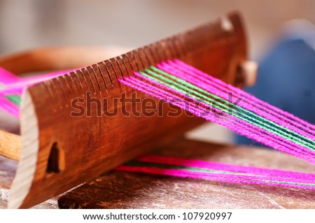 Old Chinese homemade spinning tools - stock photo