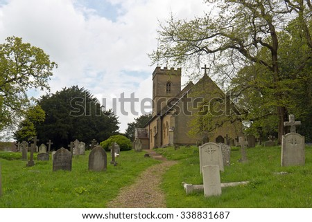 Old church and graveyard in England - stock photo