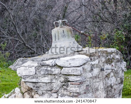 Old church Bell in the forest - stock photo
