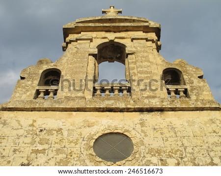Old church facade in Malta - stock photo