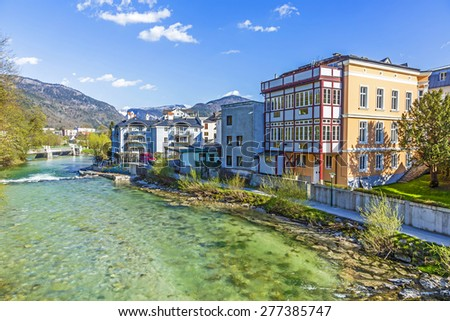 old city Bad Ischl at traun river under blue sky - stock photo