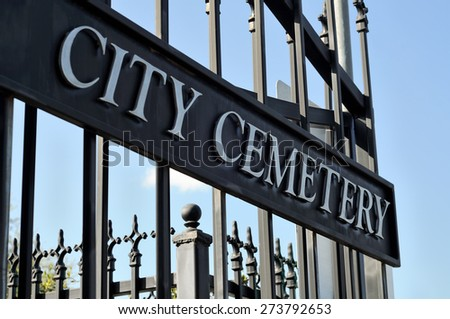 old city cemetery metal gate sign entrance, usa 18-19 century - stock photo