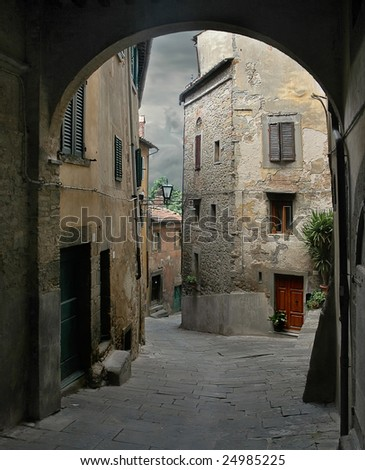 Old city street in Italy - stock photo