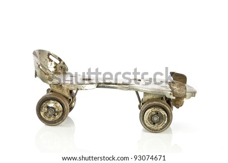 Old clamp-on roller skate on white - stock photo