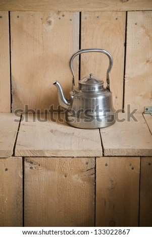 Old classic and vintage teapot on wooden texture - stock photo