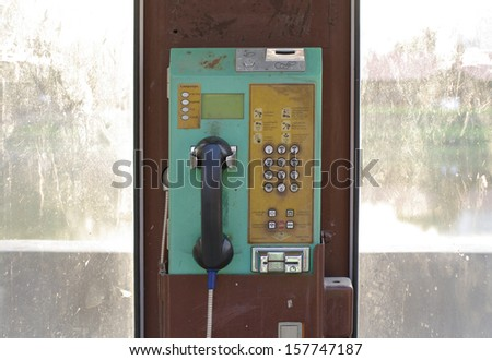 Old classic public telephone booth machine - stock photo