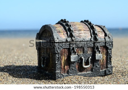 Old Classic Wood and Iron Treasure Chest on the Beach - stock photo