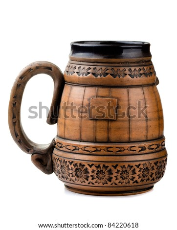 Old clay beer mug isolated on white - stock photo