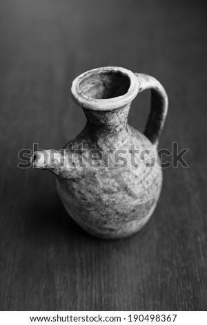 Old clay jug - stock photo