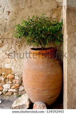Old clay spanish pitcher for production wine in Chinchon, Madrid, Spain - stock photo