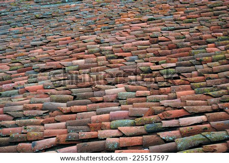 Old clay tiles on the roof. Rural architecture - stock photo
