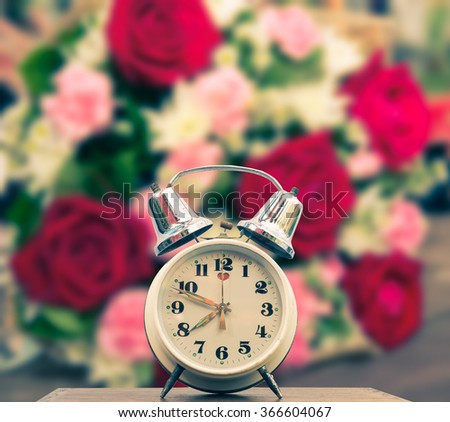 Old clock background red roses in vintage style. - stock photo