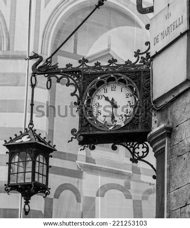 Old clock in a corner of piazza duomo, cathedral plaza, in Florence - stock photo
