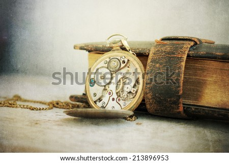 old clock  in wood background - stock photo