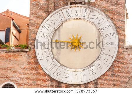 Old clock of the Church of San Giacomo di Rialto in San Polo district. Venice - stock photo