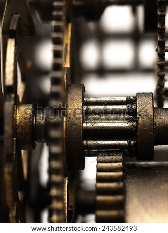 Old clock seen from the side of its mechanism together with the sprockets. - stock photo