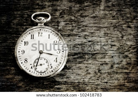 old clock vintage picture in wood background - stock photo