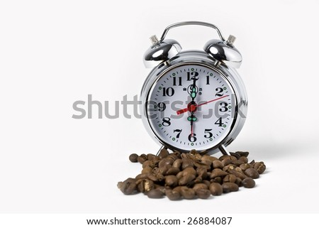 Old clock with coffee beans - stock photo