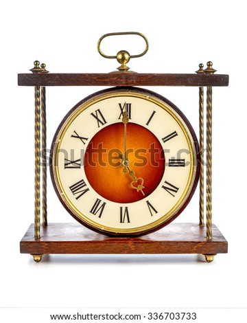 Old clock with roman numerals showing five o'clock over white background - stock photo