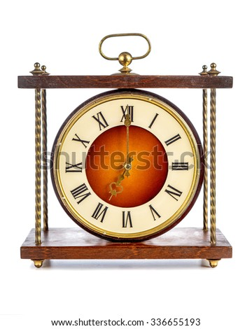 Old clock with roman numerals showing seven o'clock over white background - stock photo